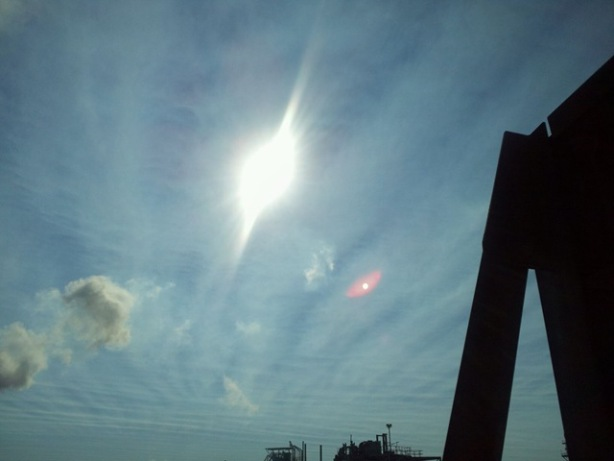 Picture of red object next to sun